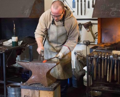 student blacksmithing